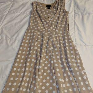 Beige a white polka dot dress.
